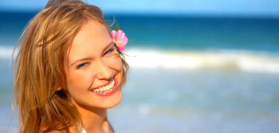 Fashion shot of beautiful woman on the beach in Hawaii